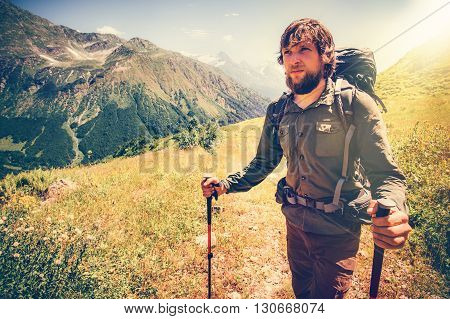 Bearded Man mountaineering with backpack Travel Lifestyle concept mountains on background Summer active vacations outdoor sunny day