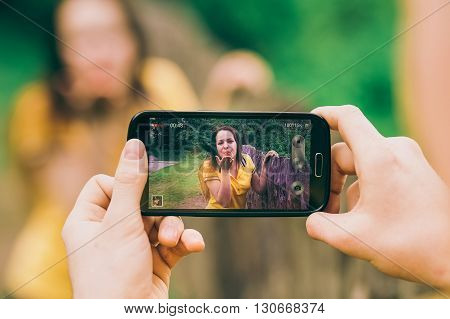 Young Man Makes Photo Of Girl Friend