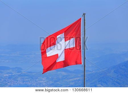 Flag of Switzerland on the top of Mt. Stanserhorn in the Swiss canton of Nidwalden.