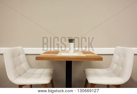Table And Two Armchairs