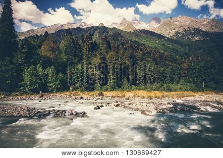 Mountains River and forest Landscape with blue sky clouds beautiful scenic view wild nature summer travel in Abkhazia