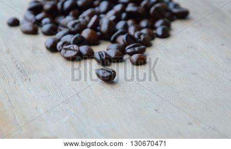 dark roast coffee bean on wooden board