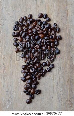 coffee bean arrange on the wooden board