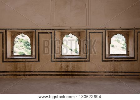 Architectural beauty inside the ancient Amber Fort complex in Jaipur, Rajasthan. Amber Fort was the residence of Rajput kings and showcased ethnic hindu art.