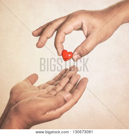 Share your love (hand giving a heart in vintage style)
