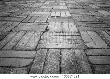 Patterned paving tiles cement brick floor background black and white tone