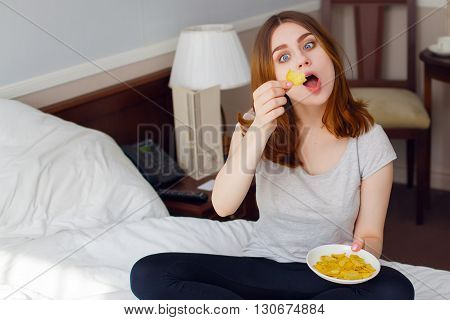 Humorous photo of young girl playing with food.