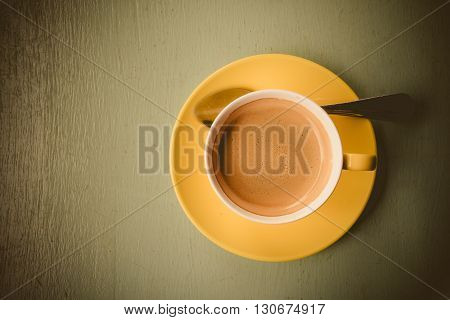Hot and fresh coffee on wooden background
