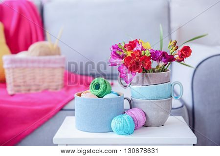 Beautiful freesia flowers on table in room
