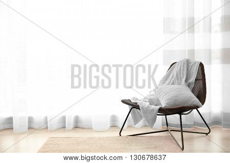 Wicker chair on light wooden parquet