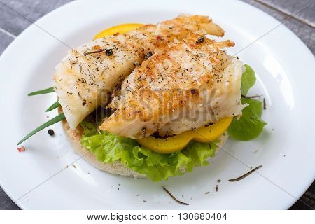Grilled Fish with vegetables on the bread