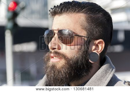 Portrait Of Young Hipster Businessman In The Heart Of City