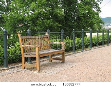 wooden bench at the handrail in the park