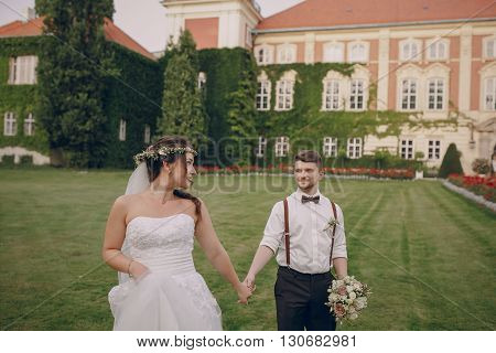 charming wedding in the old castle architecture Poland nature and the sun