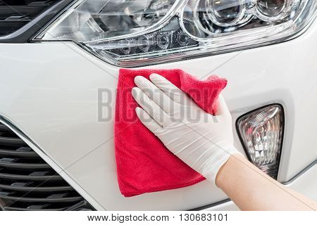 Car detailing series : Closeup of hand cleaning white car