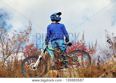 man with a mountain bike outdoors. extreme sport