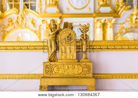 TSARSKOYE SELO, RUSSIA - MARCH 12: Antique clock in Catherine Palace at March 12, 2016 in Tsarskoye Selo (Pushkin), Russia