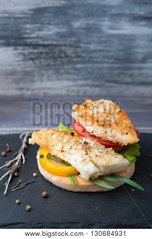 Fish grilled with tomato pepper green onion on the bread