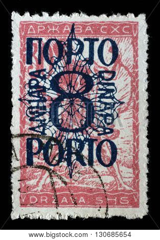 ZAGREB, CROATIA - SEPTEMBER 13: A stamp printed in Yugoslavia shows a man breaks the circuit, a symbol of freedom, circa 1919, on September 13, 2014, Zagreb, Croatia