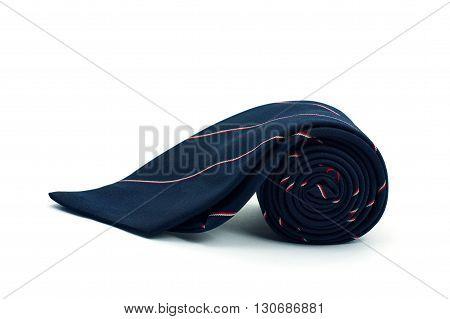 dark blue necktie on white background roll of necktie on white background