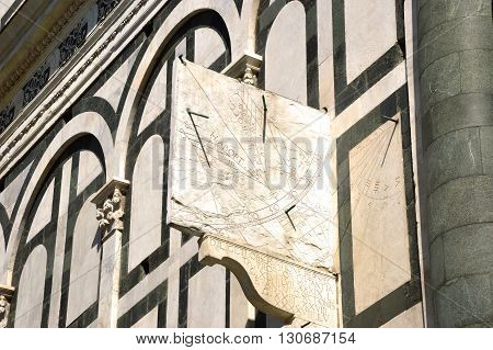 The sundial outside the Santa Maria Novella church in Florence - Tuscany - Italy