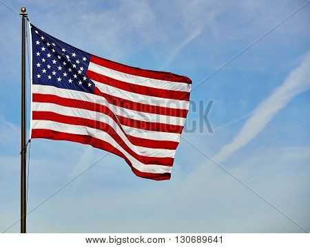 Flag Usa Waving In Wind On Pole With Blue Sky And Clouds
