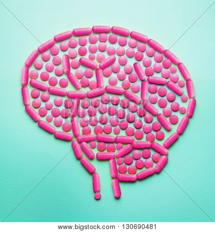 Creative medicine and healthcare concept made of drugs and pills, in the shape of human brain.