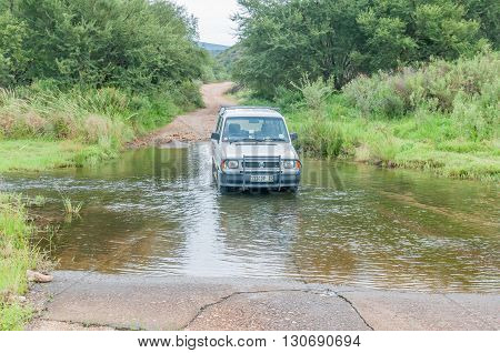 BAVIAANSKLOOF SOUTH AFRICA - MARCH 6 2016: The road in the wilderness area of the Baviaanskloof (baboon valley) crosses the Baviaans River on a concrete causeway one of many such crossings
