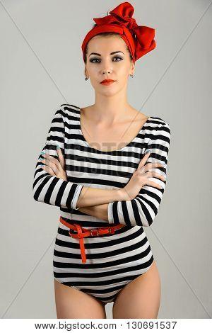 Studio portrait of a beautiful woman in sailor stripes swimsuit