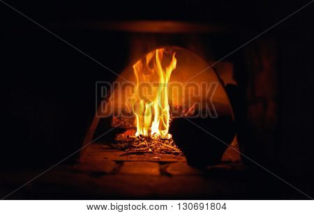 oven open with flame burn, old pot, abstract background ,natural light ,selective focus, stylized