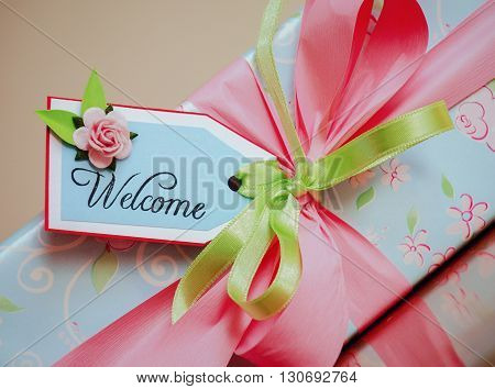 A gift wrapped box with welcome card