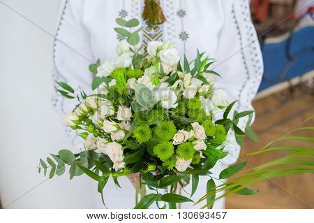 Beautiful wedding bouquet before ceremony in church