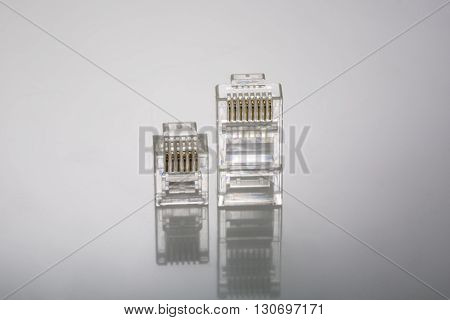 Connector rj-45 and rj-12 close-up on grey background
