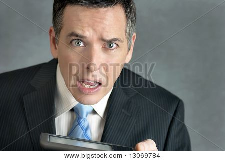 Businessman Confused By Tablet
