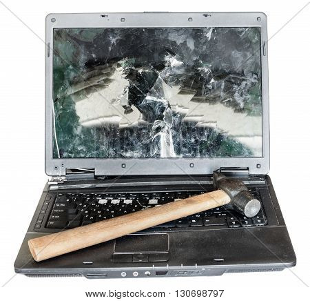Direct View Of Old Broken Laptop With Hammer