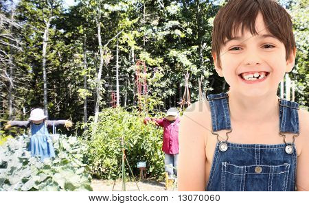 Farm Boy In Garden With Scarecrows