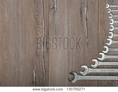 Set of wrenches. Wrenches of several sizes on a wooden background.
