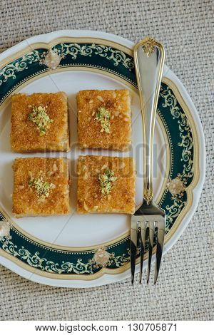 Basbousa - a middle eastern sweet made from semolina and sugar syrup. View from above.