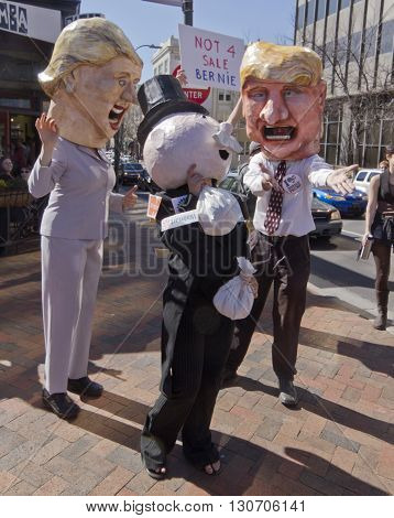 Asheville, North Carolina,USA - February 28, 2016: Parody of Donald Trump entreating Mr. Monopoly for his money as Hillary laughs in front of a Bernie Sanders campaign sign saying Bernie is not for sale