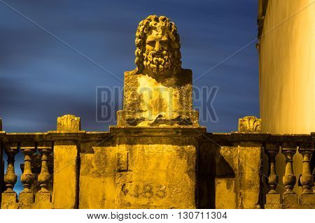 Sculpture of a Roman river god in city of Bath. A bust from 1837 displayed above a building in the UNESCO world heritage city of Bath UK