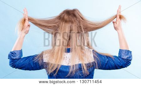 Blonde Woman Playing With Hair.
