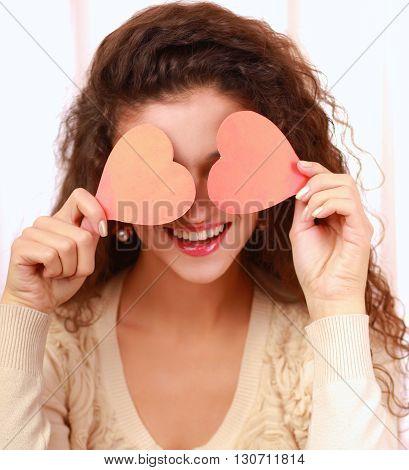 Beautiful smiling caucasian woman with heart symbol.