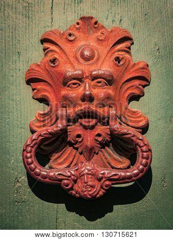 Antique door knocker of an old door.