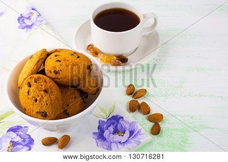 Sweet cookies tea cup and almond. Sweet dessert. Homemade biscuit. Breakfast cookies. Tea cup. Tea time. Homemade cookies.