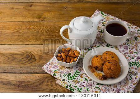 Teapot and homemade cookies. Sweet dessert. Breakfast cookies. Sweet pastry. Cup of tea. Tea cup. Breakfast tea. Homemade biscuit. Homemade cookies.