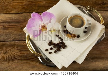 Coffee cup served on the serving tray. Coffee cup. Cup of coffee. Strong coffee. Coffee mug. Morning coffee. Coffee break.