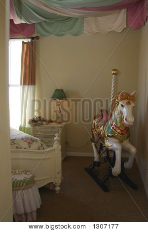 Young Girls Bedroom With Carousel Horse