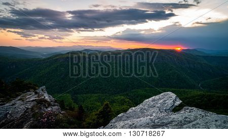 The colorful sunset from the top of Hawksbill Mountain during the spring bloom of the Rhododendrons
