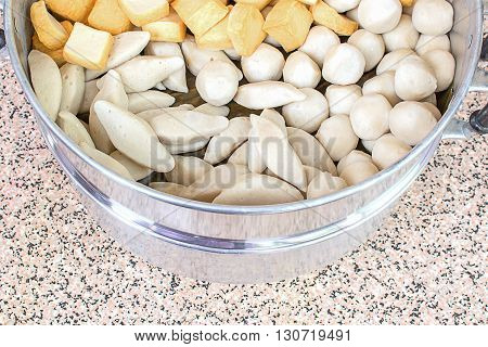 Closeup steamed fish meatball container, steaming in tray