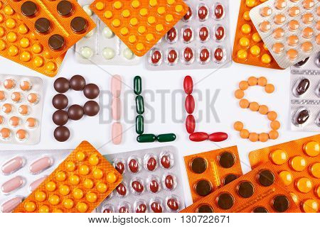 Inscription pills made of medical tablets or supplements and blisters of pills for therapy concept of treatment and health care
